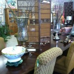 This dining room table has 2 leaves and a great price of 395.00. The chairs are priced at 119.00 a piece .